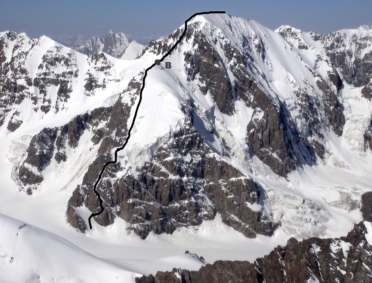 Pik Alexandra from east, with route of first ascent and bivouac.