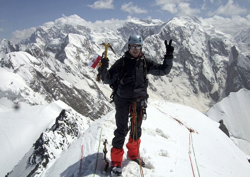 Klaudiusz Duda on M3 summit looking south at Mandaras peaks. See panorama south over Mandaras Valley for identification. Big mixed wall behind his left hand is 1,500m north face of Koh-e-Mandaras (M8, 6,331m)—one of the great ascents of the Hindu Kush, in 1977 by Poles Piotr Jasinski, Marek Kowalczyk, and Andrzej Zawada, and Terry King (UK).