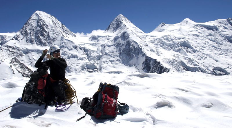Rebecca Coles on summit of Koh-e-Sauze. Behind and to south lie, from left to right; Akher Cioch (7,020m), Koh-e-Tez (7,015m), and various summits of Koh-e-Urgunt (7,038m).