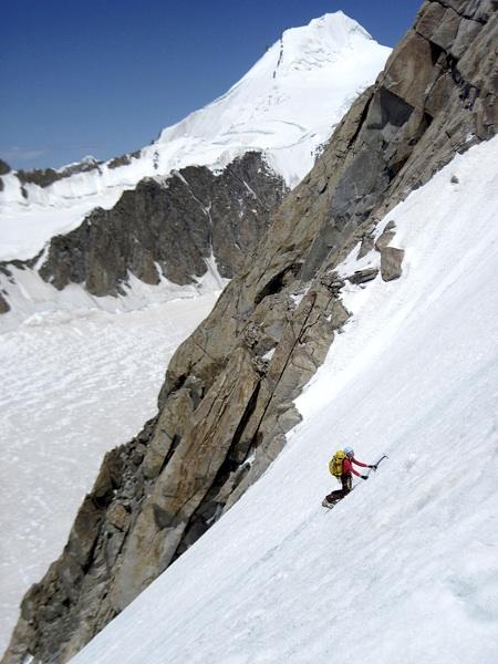 Emilie Drinkwater on first ascent of Pumo Kangri. Behind is Stegasaurus; route of first ascent followed left skyline ridge. Kirsten Kremer