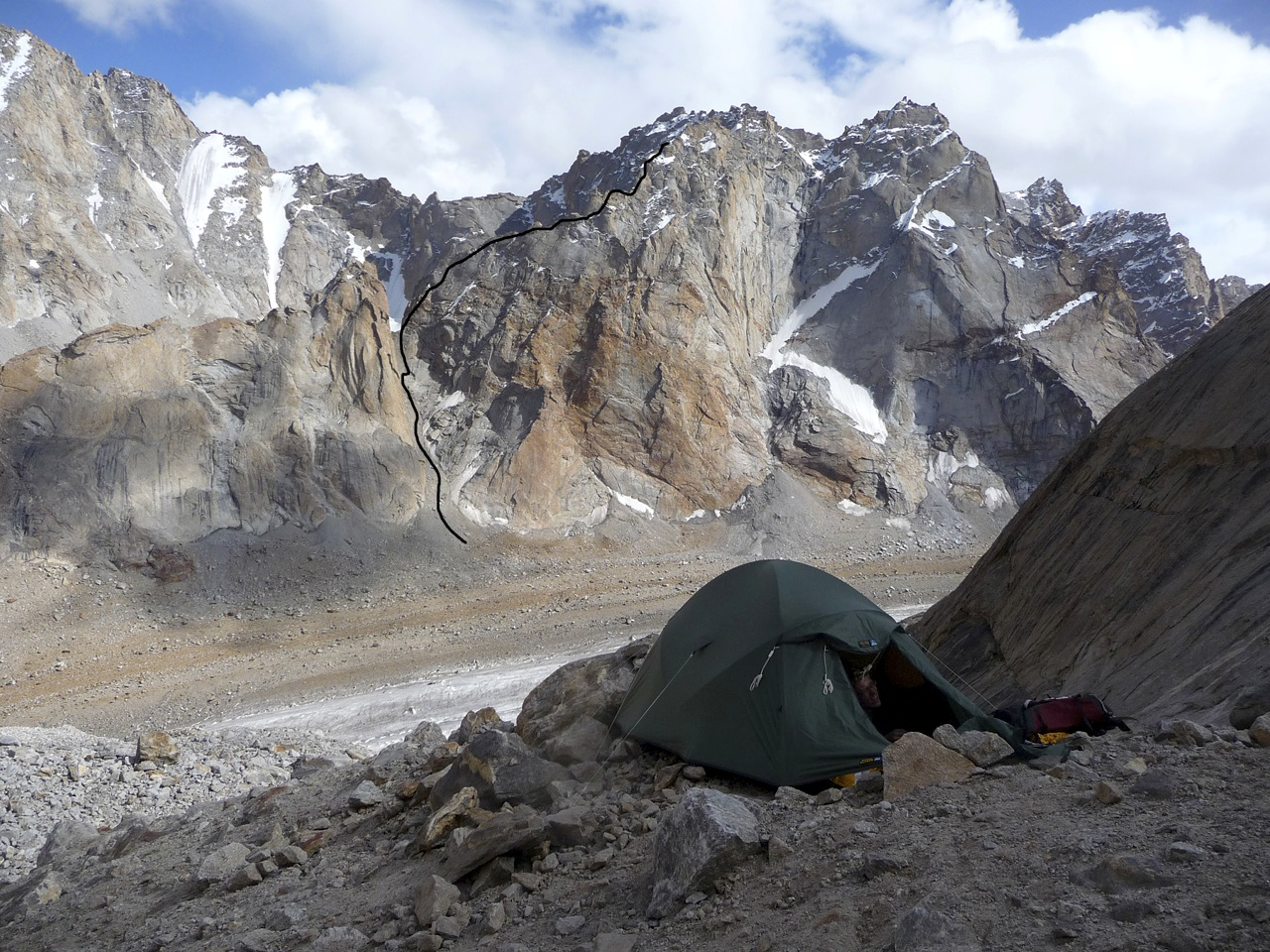 Camp at 5,300m below east gully of Lama Jimsa Kangri. Tetleh Glacier below and approximate line of attempted route on Peak ca 5,700m, a subsidiary summit of R13, marked. Johnny Bull
