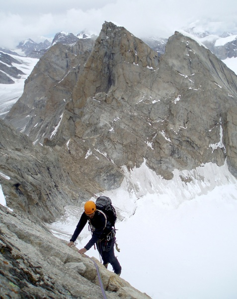 David Fajt on summit ridge of Mont Maudit, with Takdung Glacier below. Neverseen Tower in center; Triple Crown behind and to left. Martin Klonfar