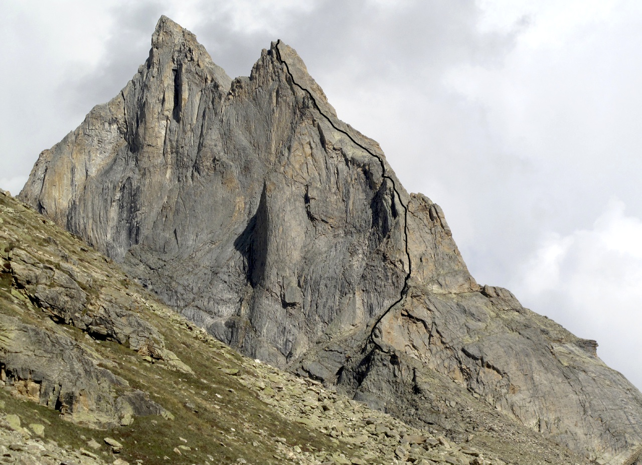 Castle Peak (ca 5,470m) from northwest, showing Four Seasons in One Day on west ridge of Iris Peak. Higher summit to left is Stefano Zvaka Peak (ca 5,300m). Main summit of Castle (Tivoli Peak) is hidden behind. Gerhard Schaar