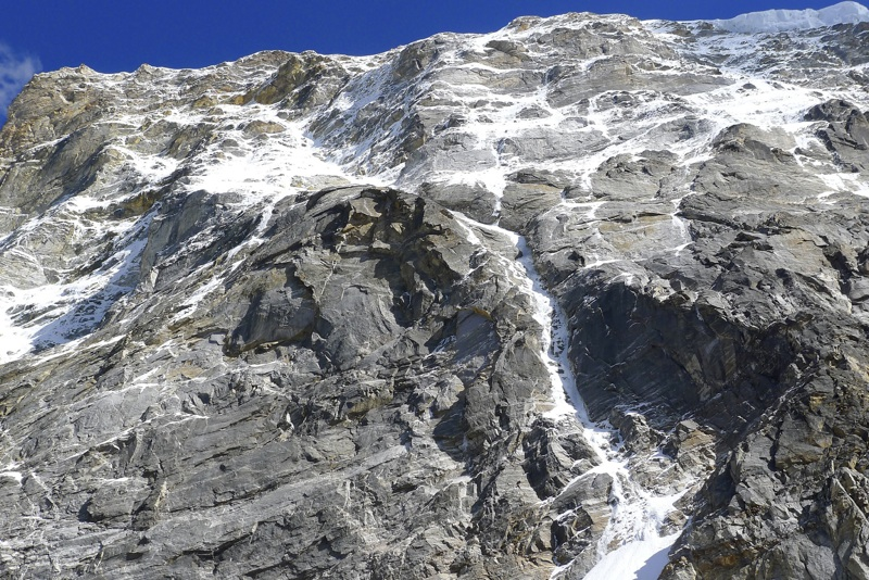 Looking steeply up west face of Gojung. Ascent followed obvious ice couloir, then snow and mixed slopes above.