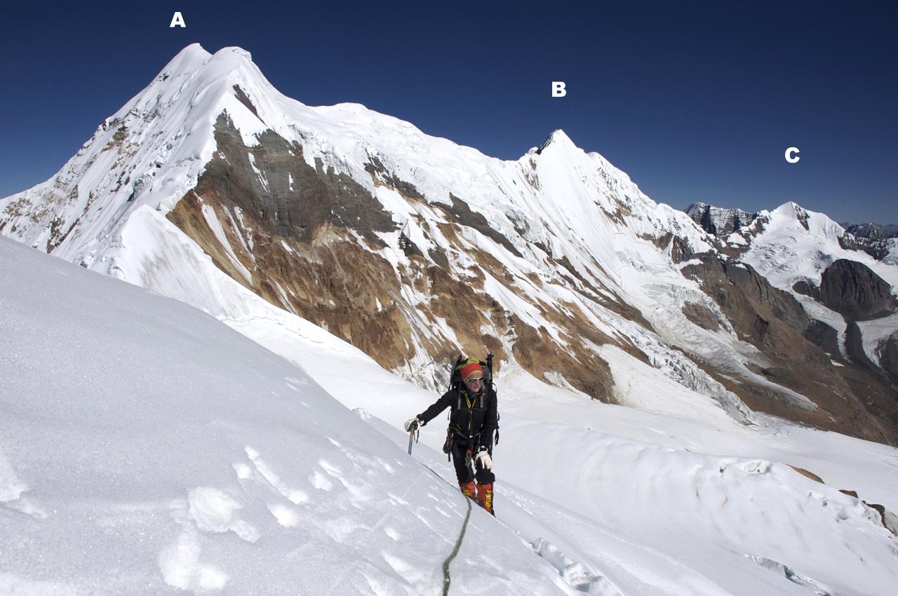 Sonia Bailiff climbing Sanctuary Peak. (A) Kande Hiunchuli (6,627m). (B) Patrasi (6,450m). (C) Peak 6,207m.