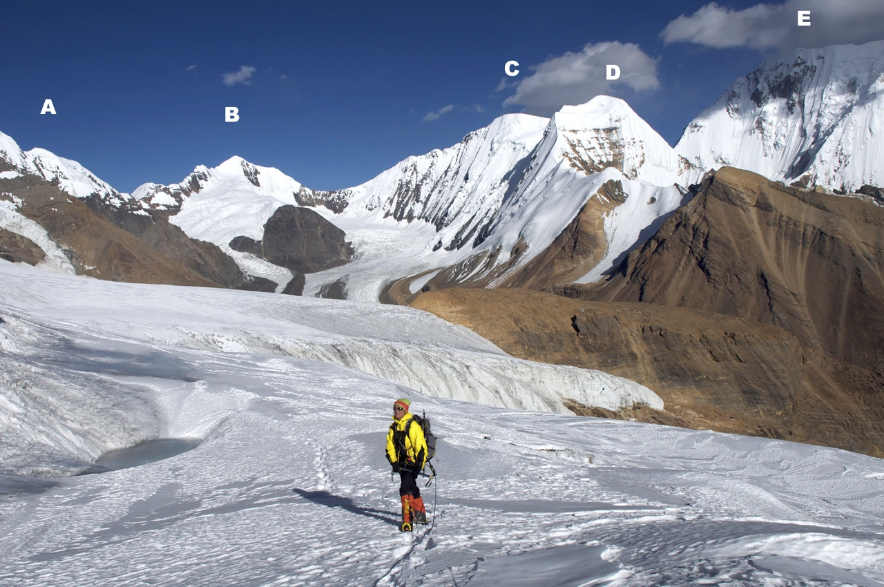 Sonia Bailiff on glaciers below Japanese Pass. (A) Peak 6,117m (Patrasi off-picture left). (B) Peak 6,207. (C) Peak 6,313m. (D) Kanjiroba Northwest (6,289m). (E) Kanjiroba North (6,858m).