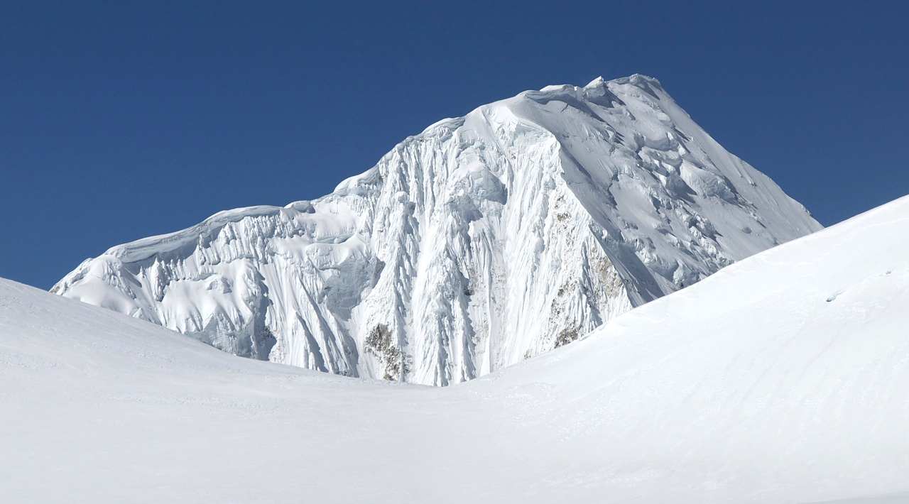 East face of Nemjung (7,140m), through 6,442m col between Panbari and Athahra Saya Khola Himal. Summit has been reached probably no more than twice. First ascensionists followed left skyline.