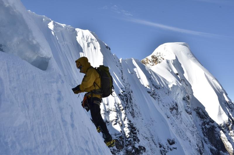Daliu high on north face of Yangmolong. Summit of Makara (6,033m) right.