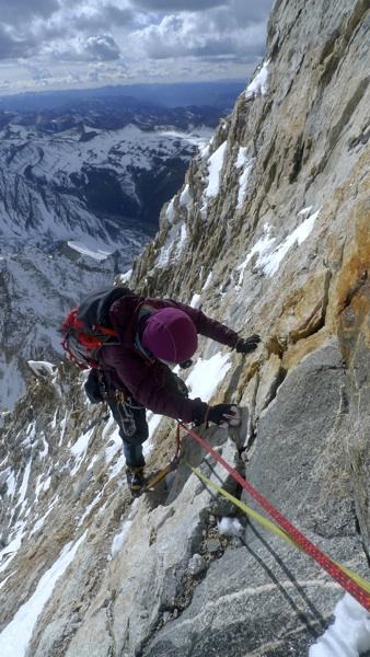 Li Shuang traversing high on south face of Xiao Gongga.