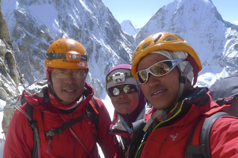 From left to right, Yan Dongdong, Li Shuang, and Zhou Peng at 5,650m on south face of Xiao Gongga. Behind lie west face of Jiazi (left) and north face of Grosvenor.