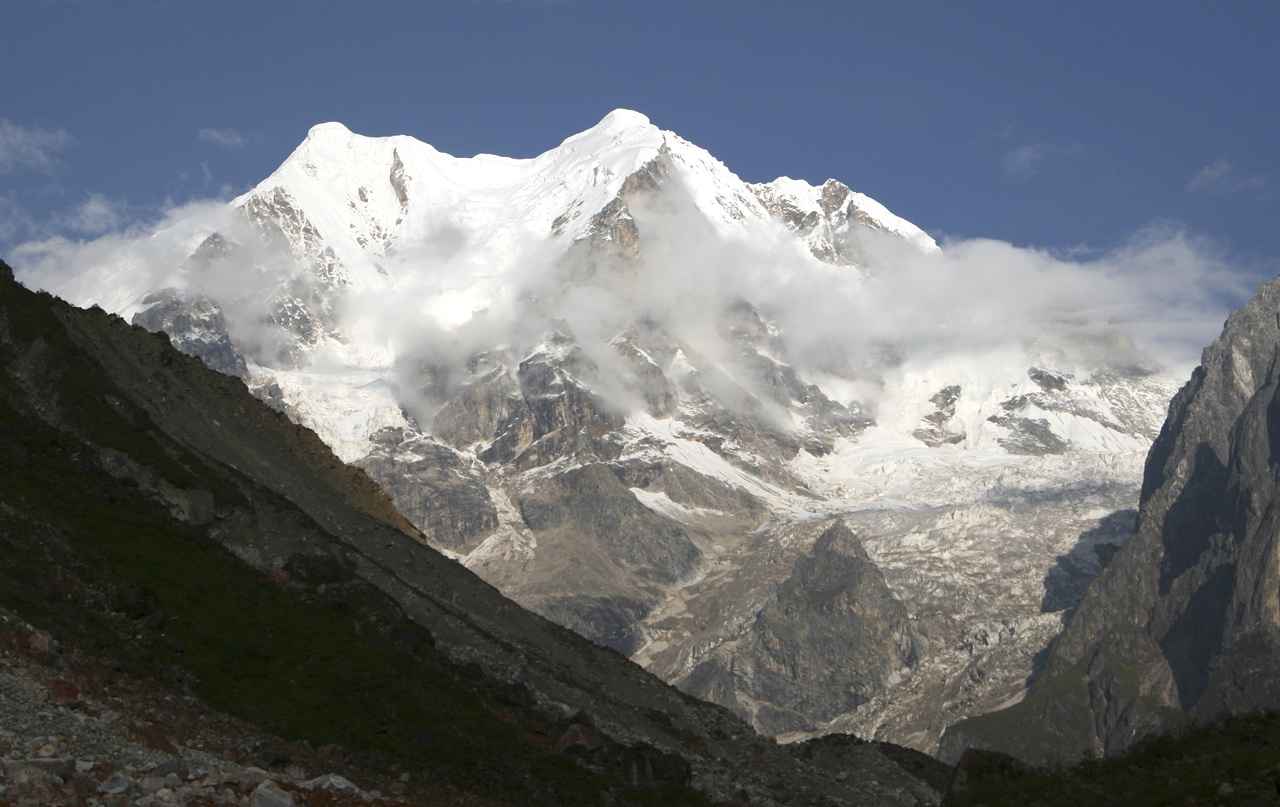East side of Jiazi (6,540m, north summit) from Russian base camp in e Nan Men Guon Valley. In 1982 Americans Dave Stutzman and Jim Williams made an alpine style ascent of West Face, reaching summit ridge after eight bivouacs. A cornice collapse and dropped sack stopped them from continuing along crest to highest point, and they descended east face in search of sack. From bottom they headed northwest and crossed a col on Jiazi's northeast ridge, descending far side to reach Tshiburongi Glacier and eventually base camp. A remarkable round trip.