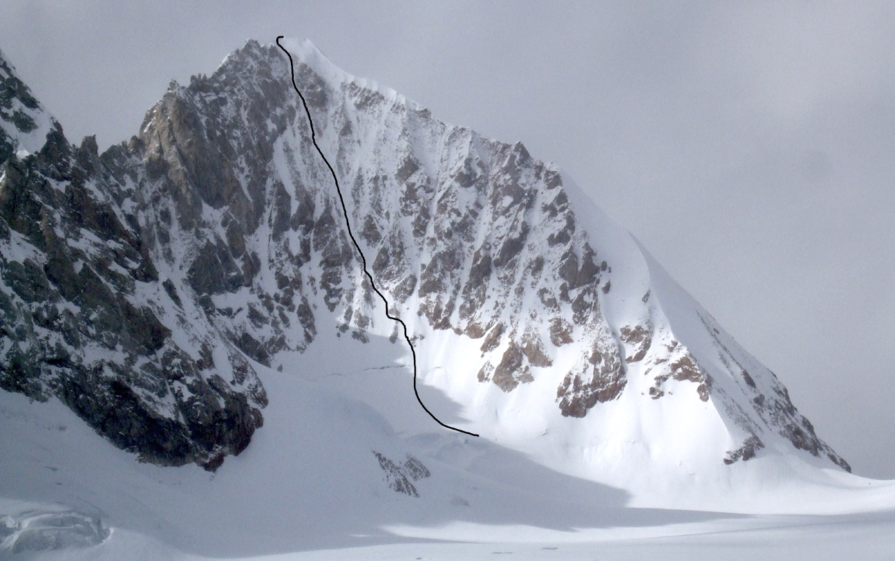 East face of Grosvenor, showing new Russian route. Top section probably coincides with American rappel descent, which continued down more directly than Russian route. Grosvenor-Jiazi col on right.