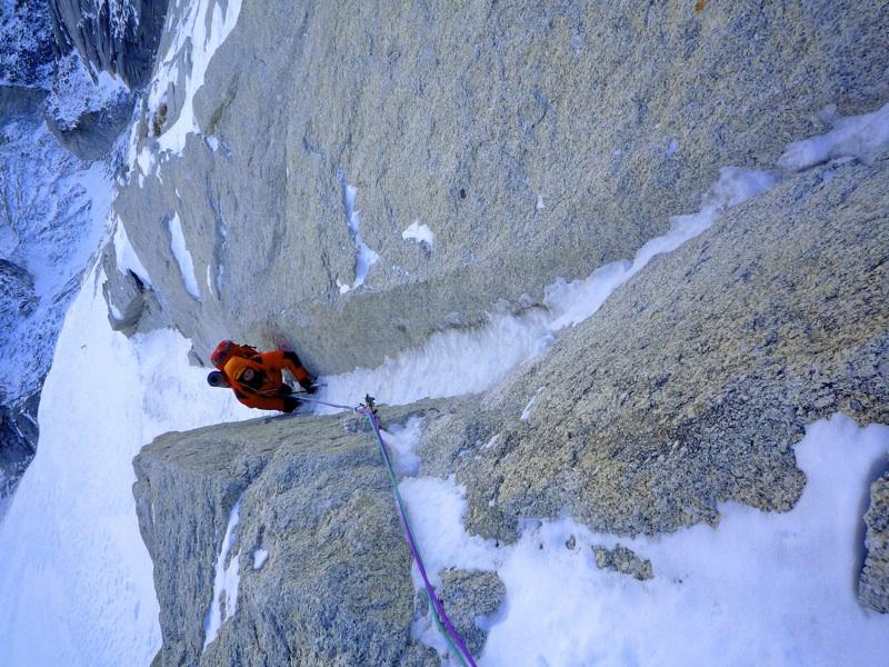 Baguet climbs a fine couloir high on Ni Hen Piao Liang.