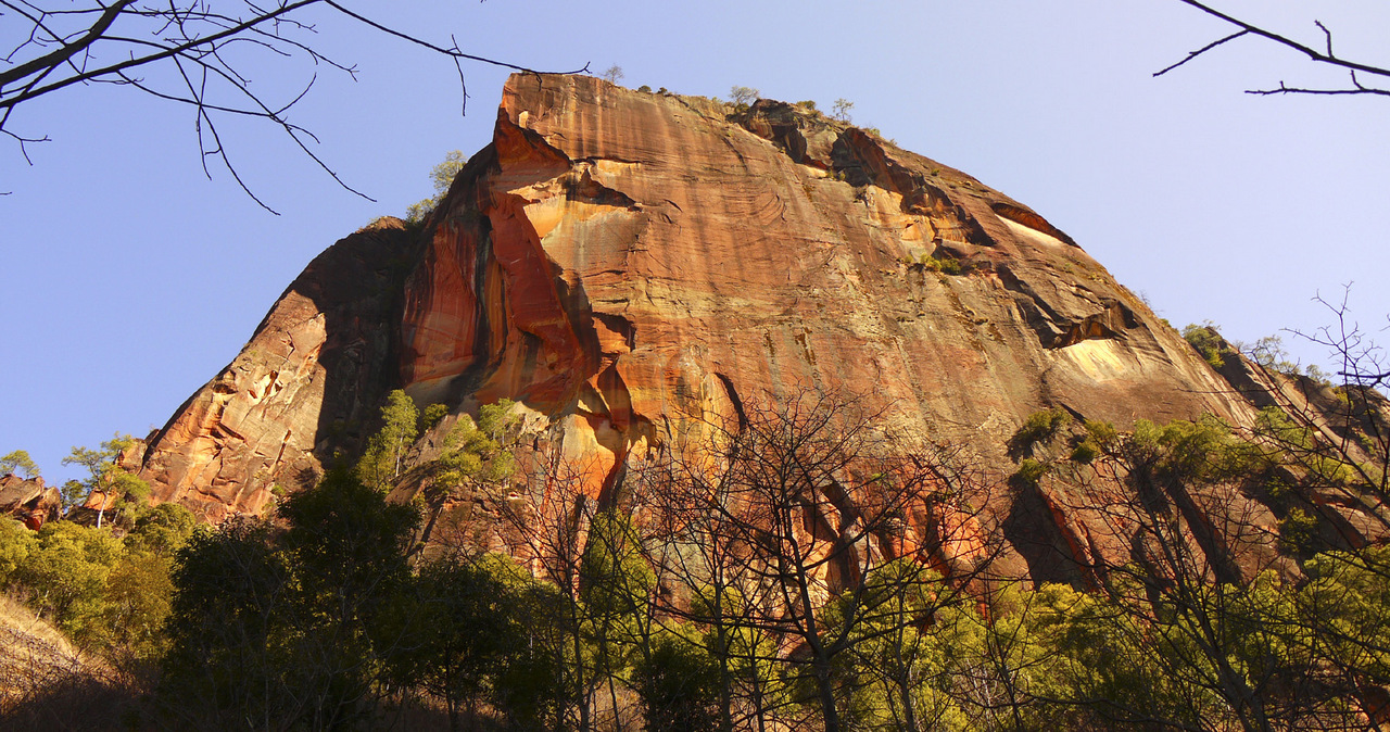 Lisu area, East Buttress. Established climbs are on left side and on pillars at base of front face.