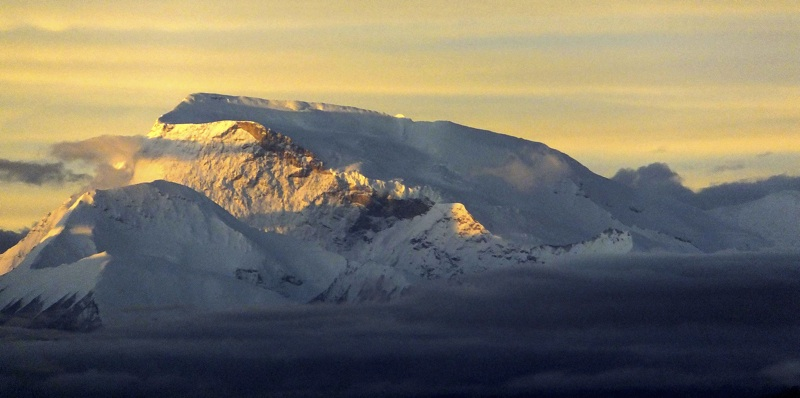 Gurla Mandhata from Kailash. Original Route climbs giant northwest slope behind sunlit ridge. Smaller snow peak on left is 6,912m.