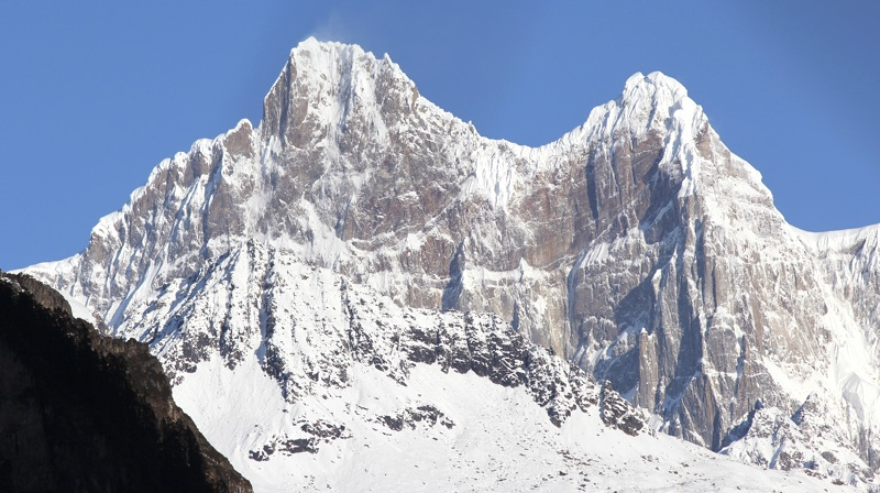 Southeast face of Jongpo Po Rong (6,570m) rises above middle branch of the Jiangpo Glacier.