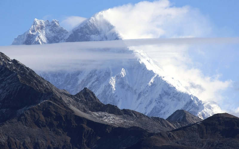 Gyala Peri (7,294m) from southwest, climbed only in 1986 by Japanese expedition via west face and south ridge (between shade and sunlight).