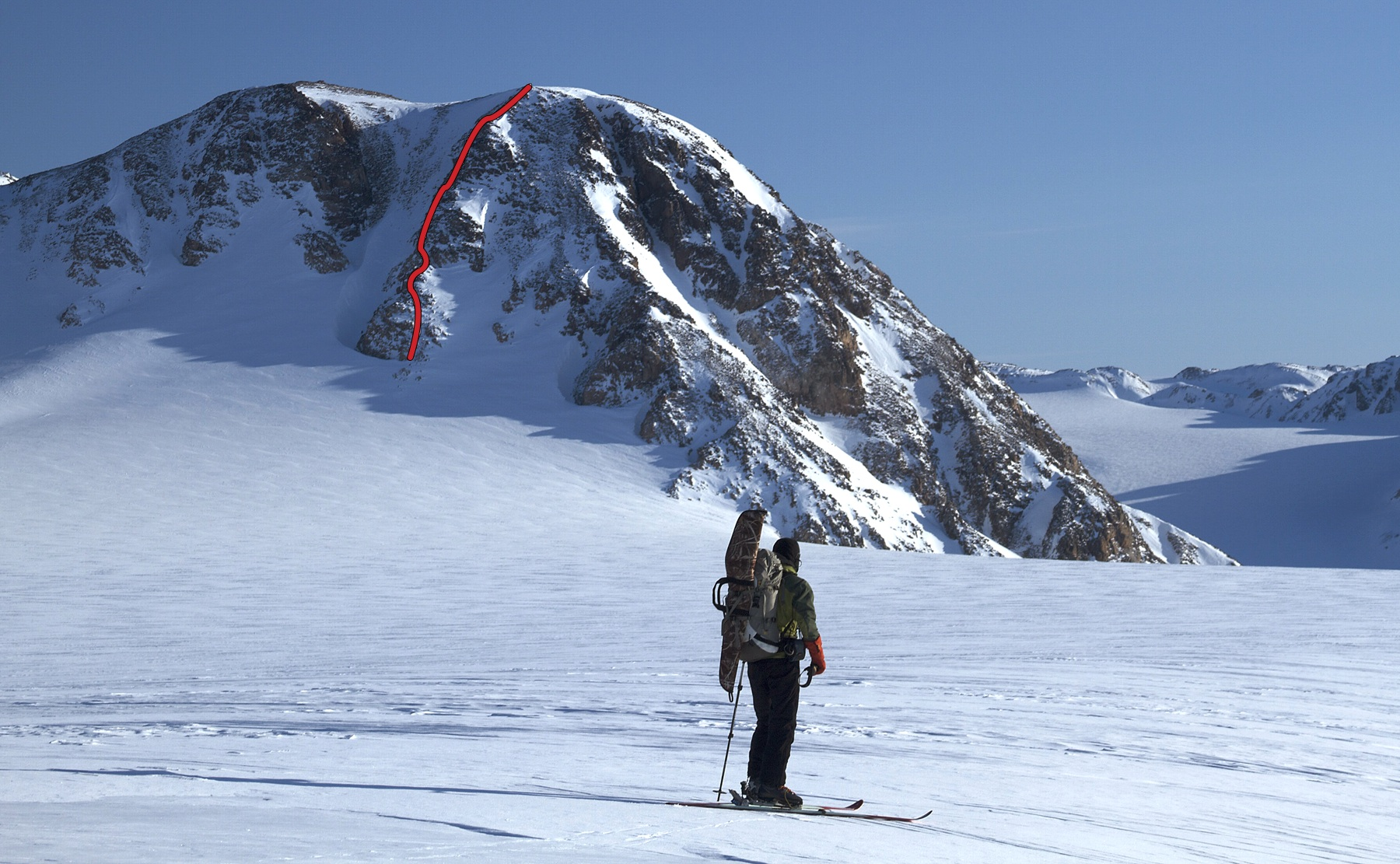Natasha Sebire stands in front of Castle Peak, with the Australian route marked.