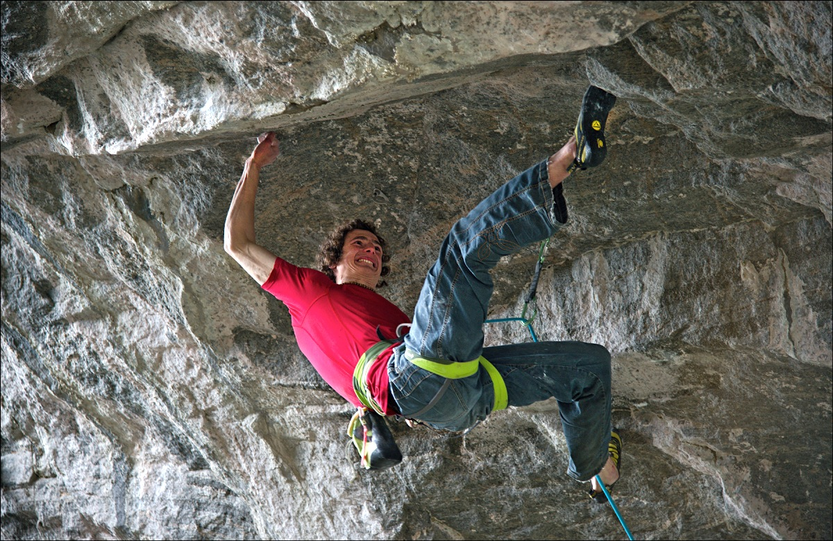 In the middle of the crux boulder problem, itself around V14.