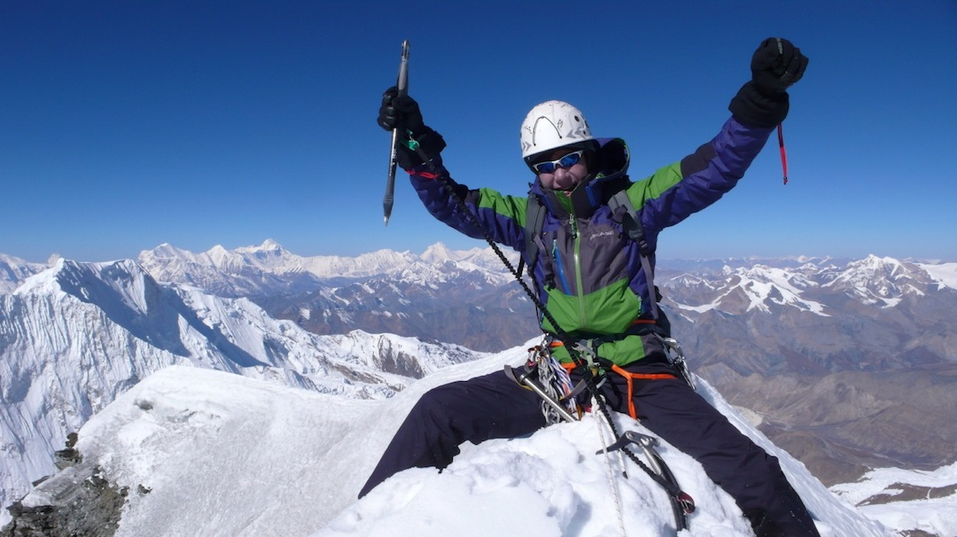 Ahn Chi-young on the summit of Himjung. In the distance, under his right elbow, is Dhaulagiri. Farther to the left on the skyline are Annapurna, Gangapurna, and Annapurna III (right to left). In the foreground on the left is Gyaji Kang. The Damodar Himal is to his right.