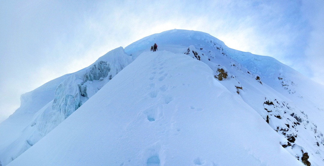 The upper exposed snow ridge.