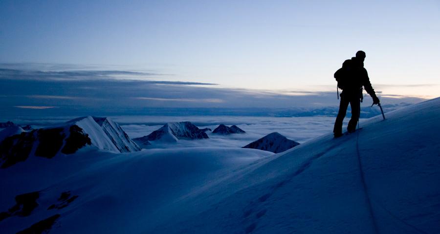 Boris Korzh on the summit of  Forgotten Peak.