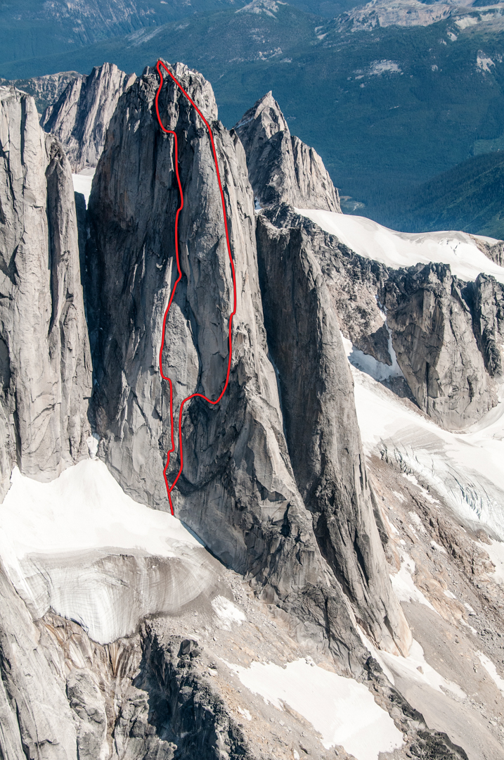 South Howser Tower. Compassion Club (left) climbs a massive chimeny system; it was climbed free and onsight in a day. The Wandering Direct (right, approximate) links features across the northwest face before joining the Beckey-Chouinard.