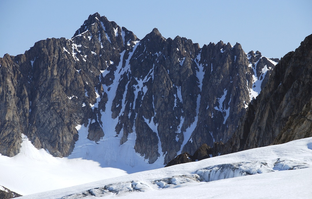 Viking Peak is the highest summit and was climbed via the main snow couloir to a small saddle, and then up the rocky ridge to the summit. Elf Peak is the prominent rocky top just right of the small saddle, while Dwarf Peak is hidden behind it.