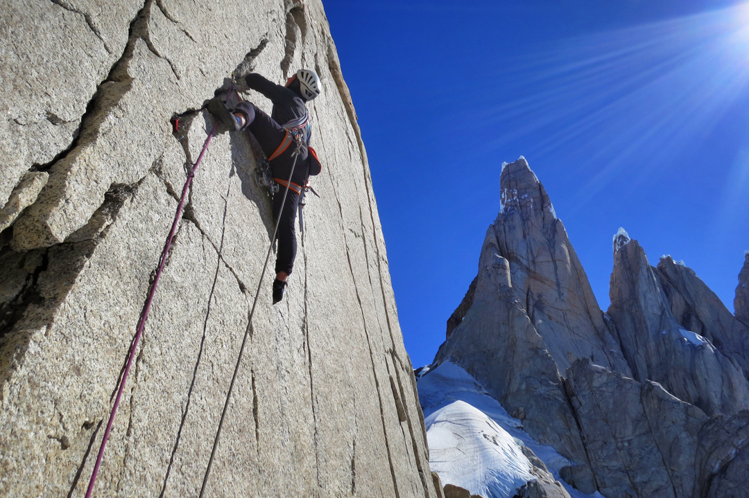 Luka Krajnc leading solid cracks on Dulce de Leche, a 400m new route on El Mocho. The Torres in the background.