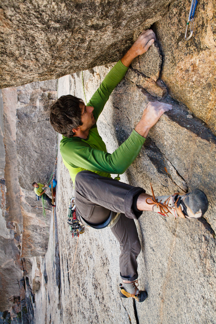 Reed throws a heel hook on the steep end to Pitch 3 (5.11).