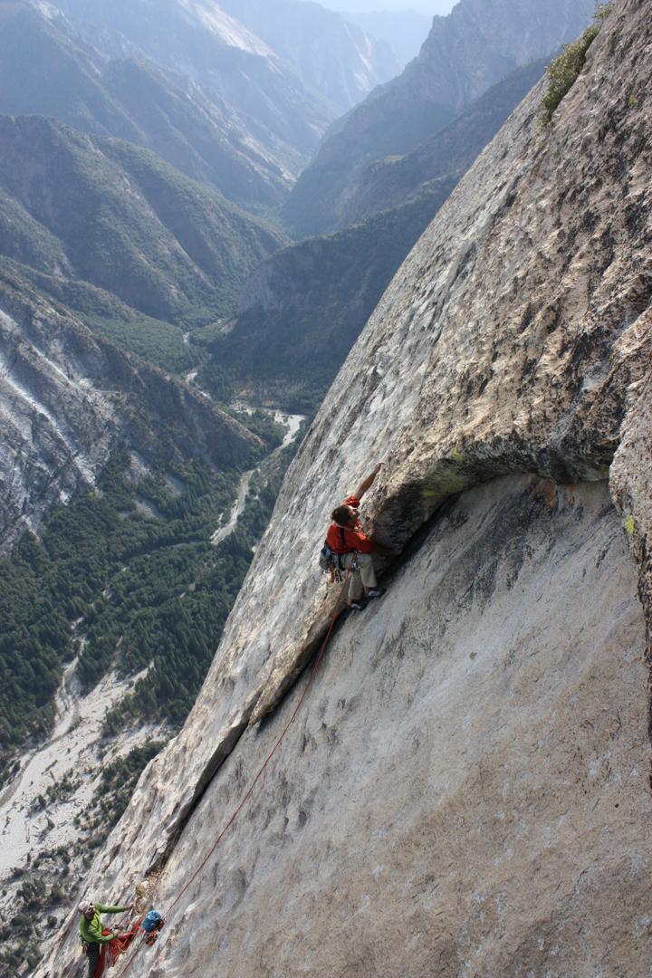 Wilson climbing up featured rock.