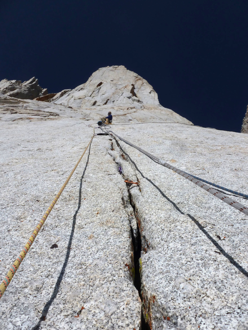 Moser belaying a steep crack below the Great White Shield on Blood of the Monkey.