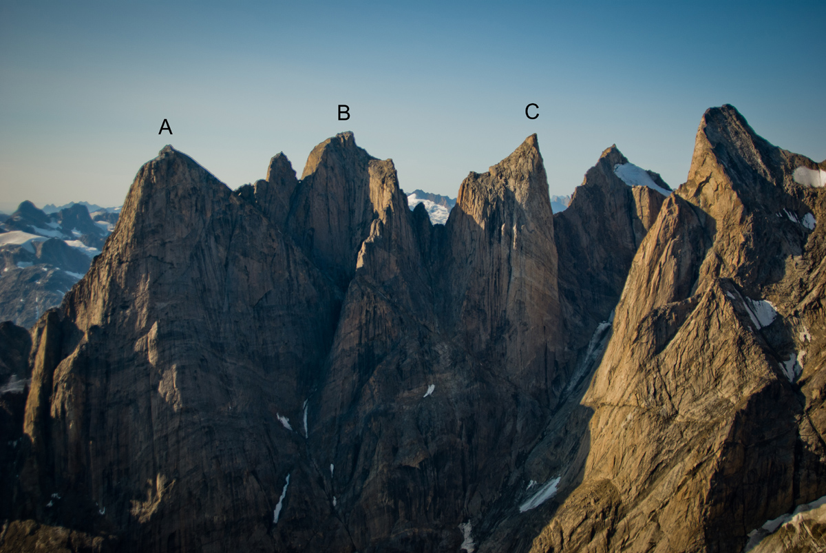 North faces of the towers of the southern branch of the Mythics Cirque. (A) Father Tower, center of north face, first climbed by Libecki and Pringle, 2012. (B) Hidden Tower, climbed via the south face (not visible). (C) Siren Tower, unclimbed. The other two peaks are also unclimbed.