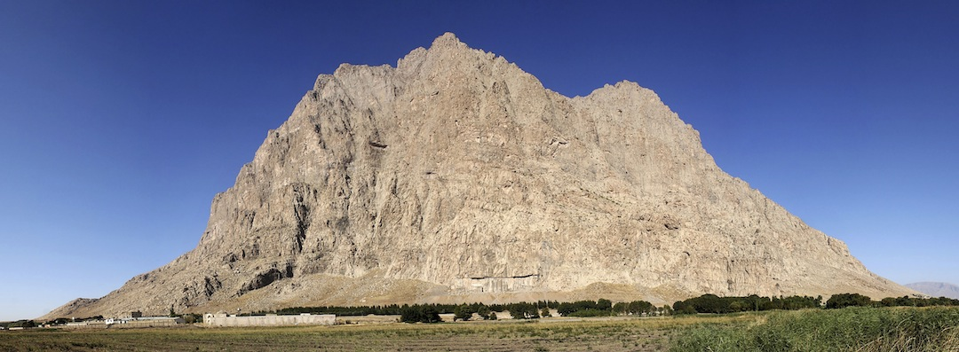 The southeast face of Bisotoon rises behind a caravanserai where participants in the second International Rock Climbing Festival were housed.