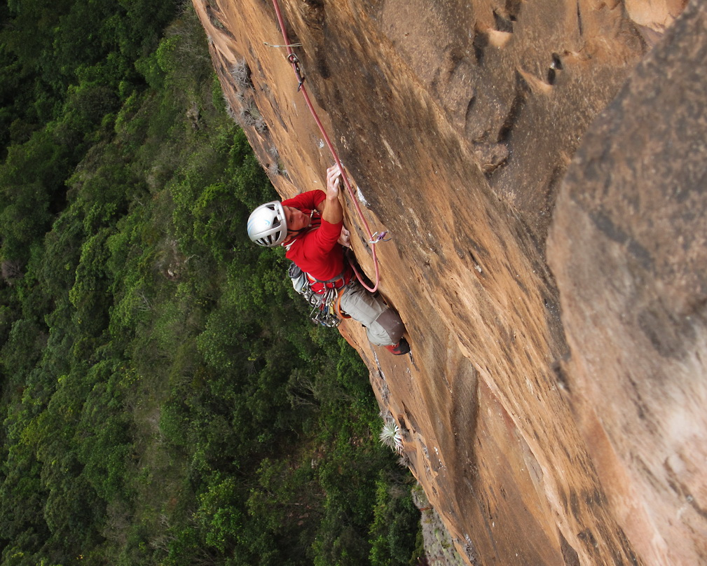 Obid reaches for crimps on the steep face of Purgatory (VI 5.12+).