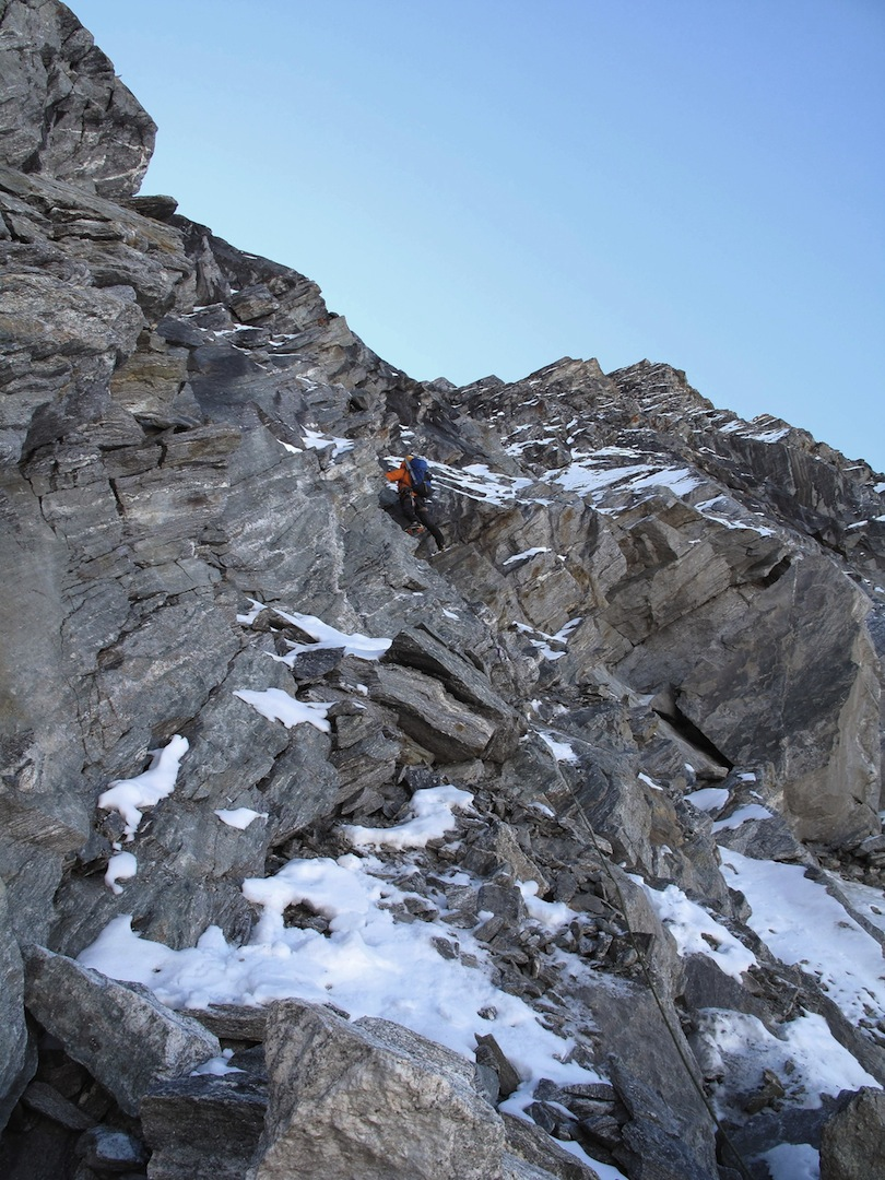 Rousseau starting the mixed ground on the west face of Pt. 5,766m.
