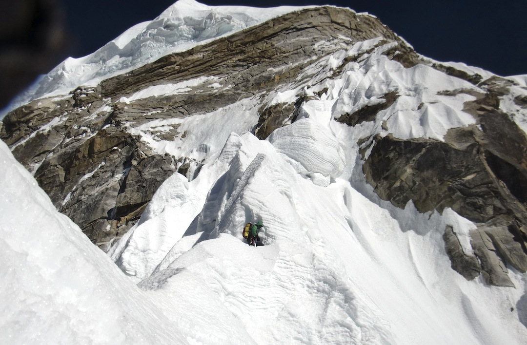 Kyashar, day five. A foreshortened view of the crux snow arête, with the granite headwall and capping seracs visible above.