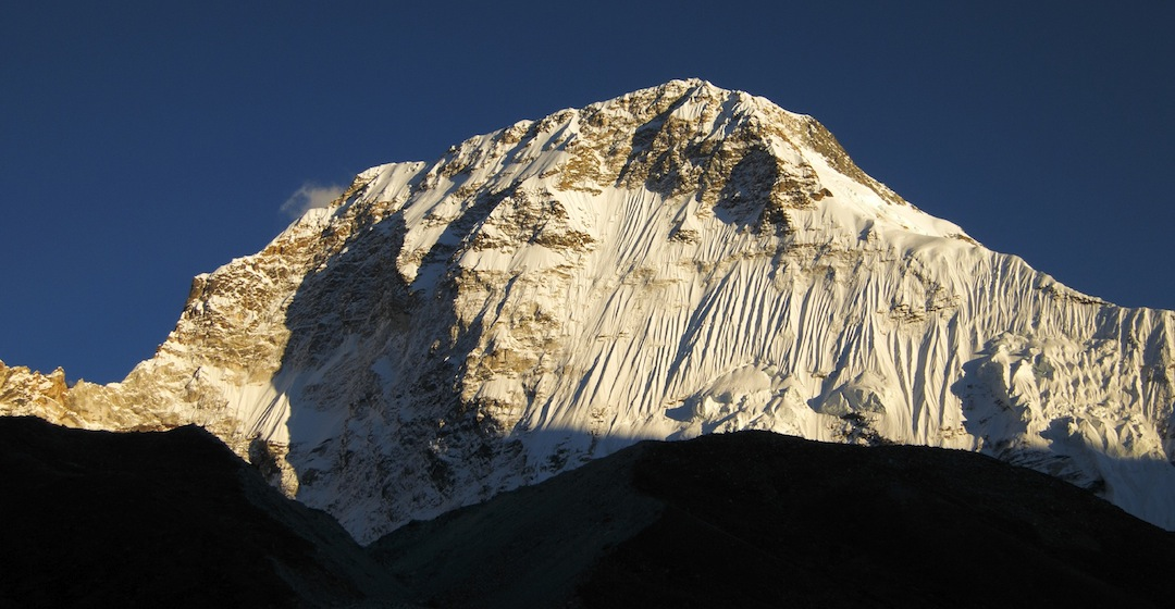 The unclimbed north face of Chamlang. This, the main summit of the Chamlang massif, has been climbed five times; three from the south, and two via the west ridge/face (right skyline).