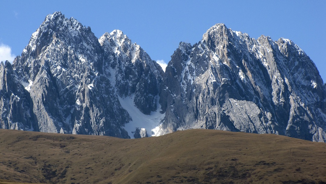 The central (and eastern) Gangga Massif seen from the north-northeast. From left to right: Peaks 5,429m, 5,400m, and 5,286m.