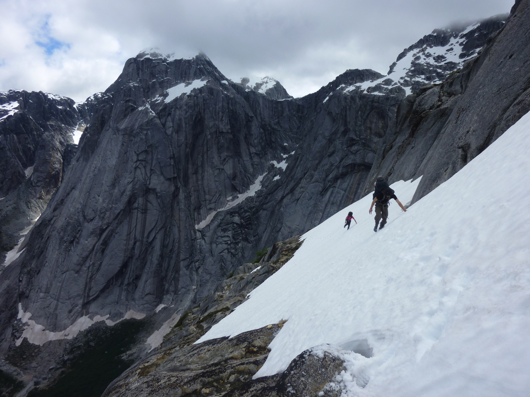 Traversing a high snowfield helps gain access to the wall.