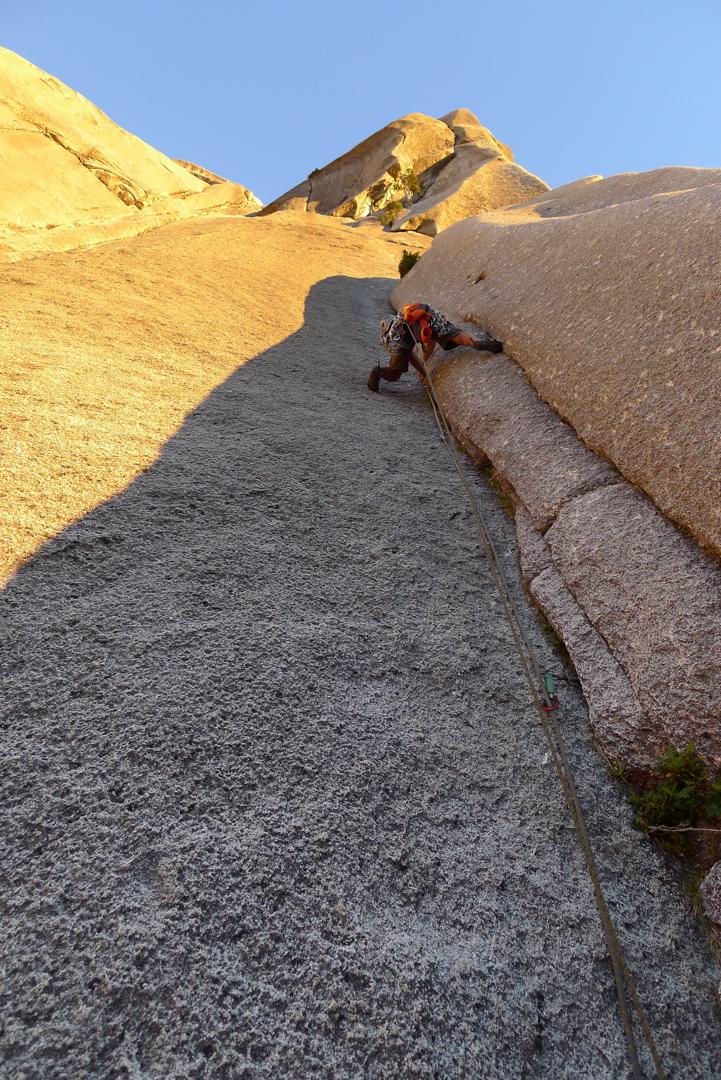 Steep crack climbing on featured granite.