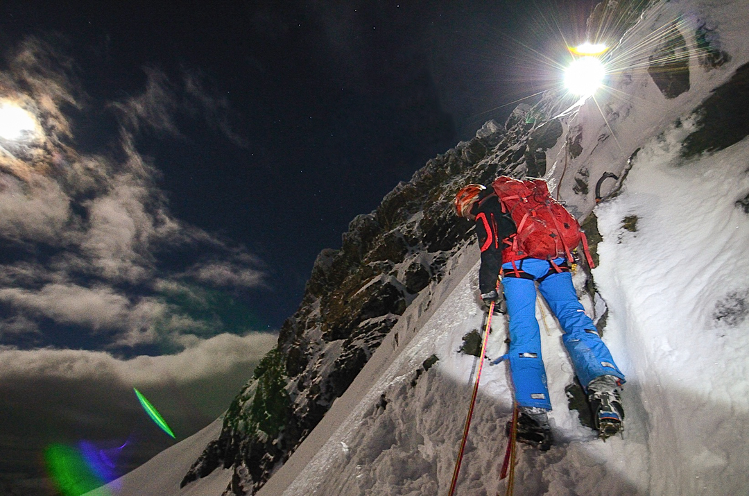 Robert Jasper rappelling in the dark after a short weather window allowed the team to make a rapid ascent of Monte Giordano's west ridge.