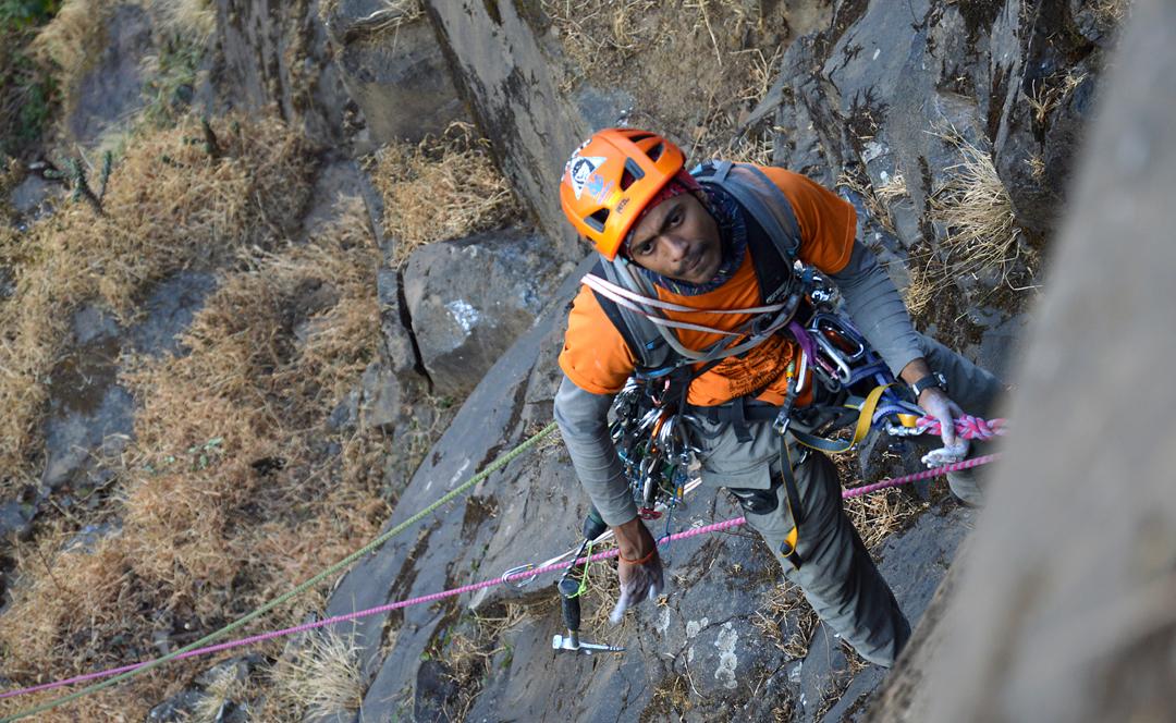 Big wall climbing in the Sahyadri. Samiran Khole 10m below the exit from the Dhakoba Wall.