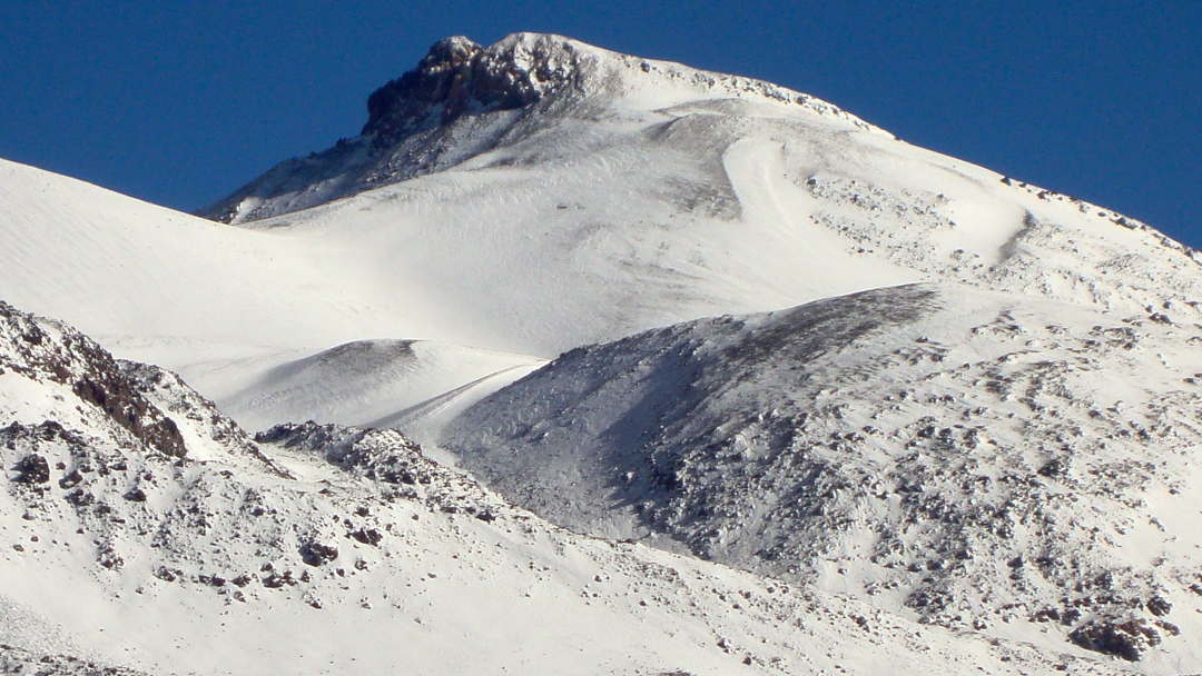 Ojos Del Salado (6,893m), the highest volcano in the world, covered in fresh snow during the Basques' massive traverse. The climbing was primarily nontechnical, but the team covered over 200km in eight days and tagged five summits over 6,000m, including a new route on El Fraile.