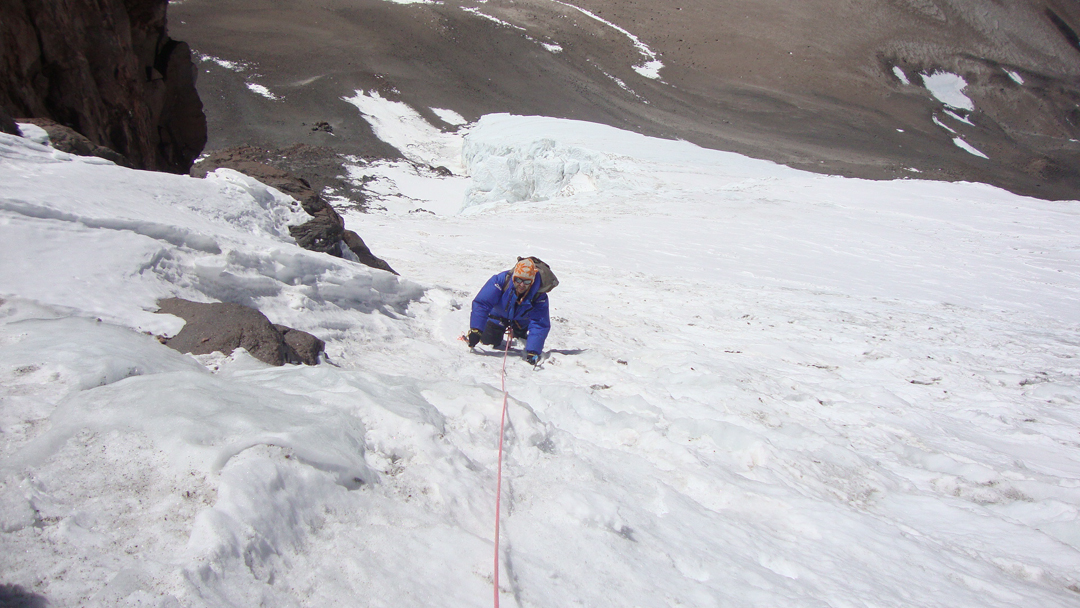 Following the steep, hard-packed glacier.