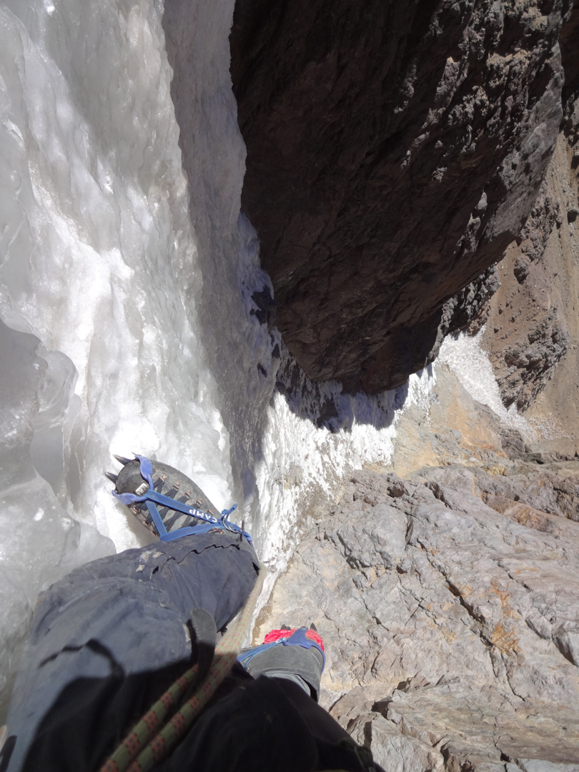 Climbing through an ice filled chute.