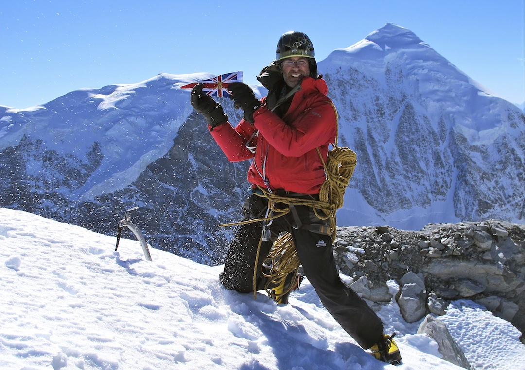 Duncan Francis on the summit of Wupingfeng with the impressive north-northwest face of Lamo-she in the background.