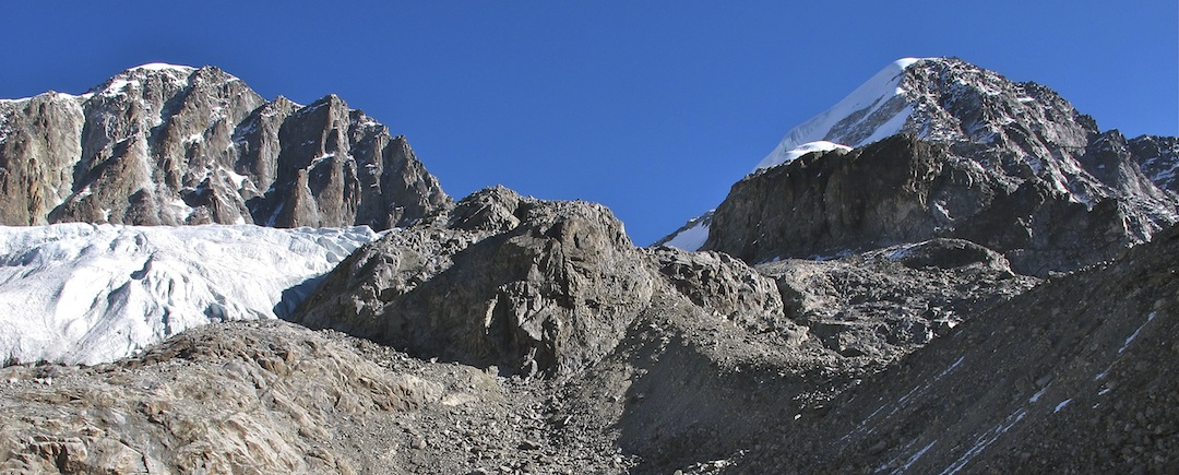 Szepingfeng (a.k.a. Shehaizishan, 5,878m, left) and Wupingfeng from the moraine approach. The December 2012 ascent followed the left (north) skyline ridge.