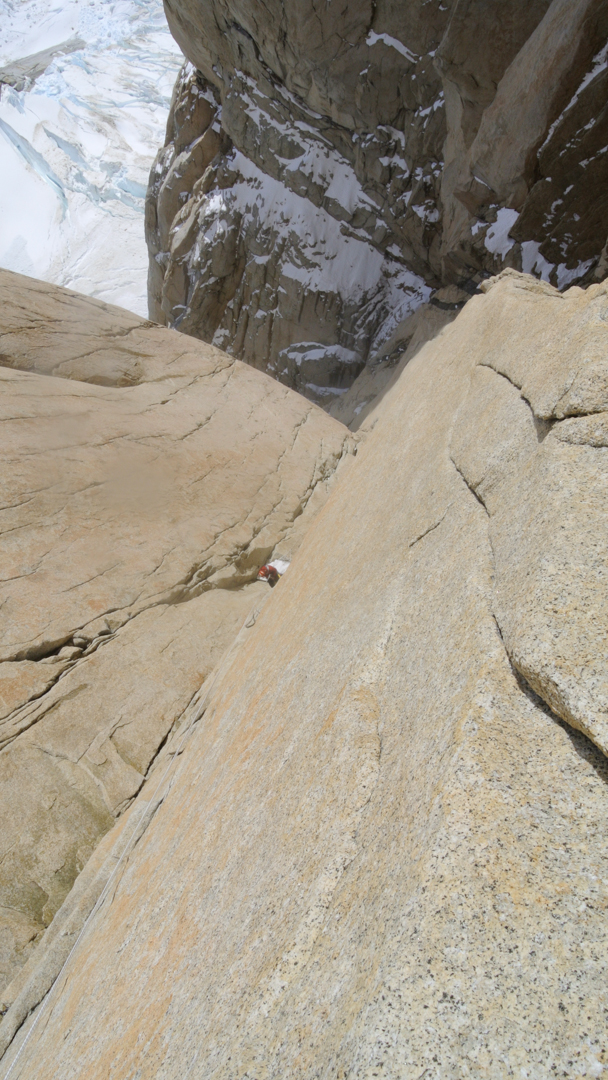 Climbing a clean corner high on the west face of Torre Egger.