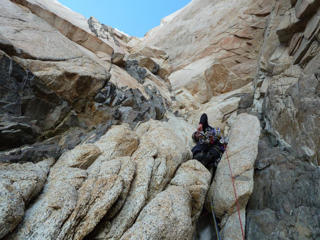 Avoiding the black diorite bands on Torre Egger.